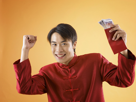 man excited with the gift packet containing money Banco de Imagens
