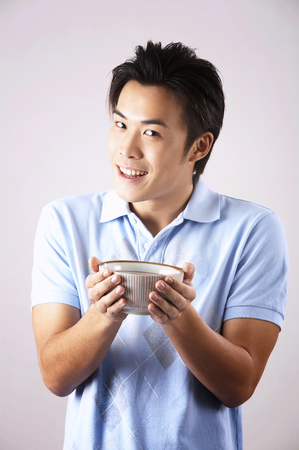 man with casual wearing holding a bowl