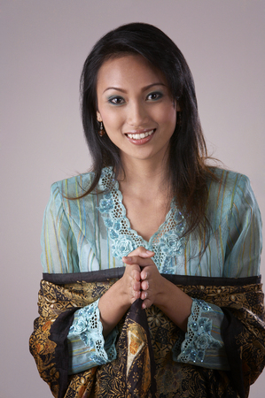 malay woman with hand gesture -salam