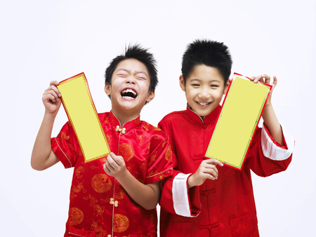 two happy boys with chinese couplet