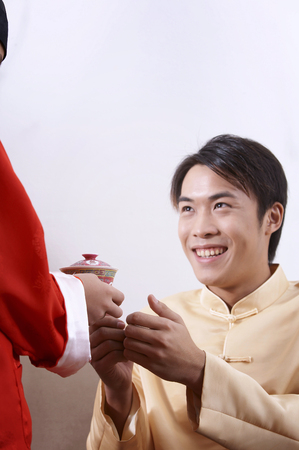 boy offering tea for his father during chinese new year Reklamní fotografie