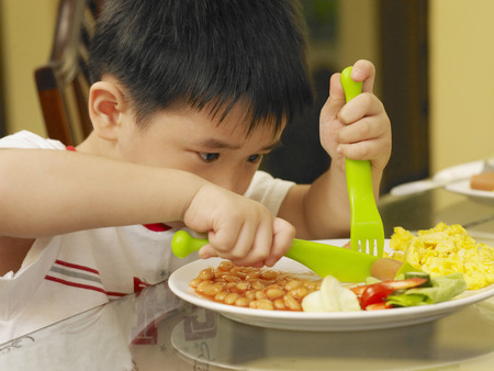 boy eating breakfast at home Stock Photo