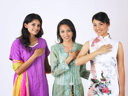 malay,chinese and indian standing together