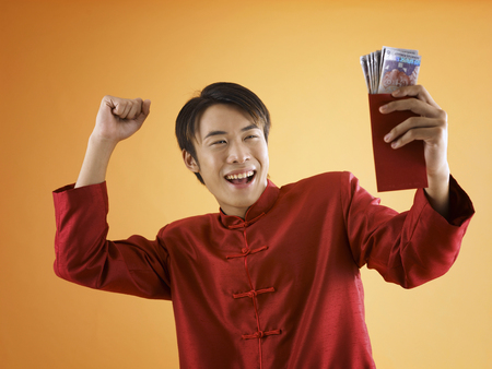 man exciting with his packet of money