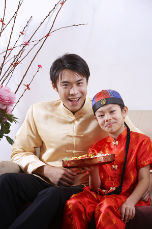 man and boy holding candy tray Stock Photo