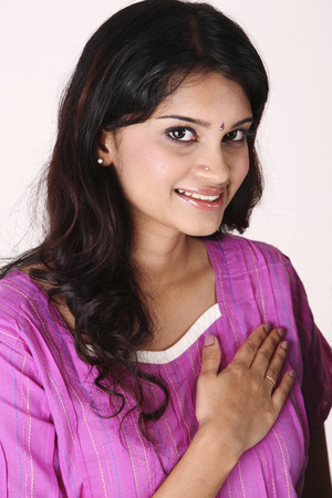 indian woman with hand gesture- welcome