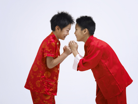 two boys exicting for chinese new year