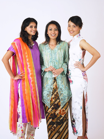 three friends happy and standing together Stock Photo