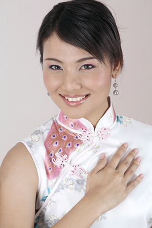 chinese woman with hand gesture- welcome Stock Photo