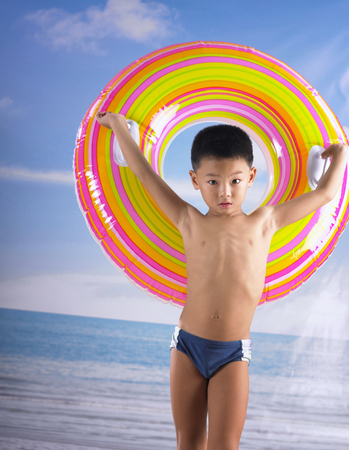 boy holding infllatable ring 스톡 콘텐츠