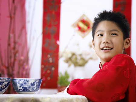 A boy in happiness during chinese new year
