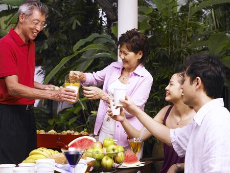 family waiting for the orange juice