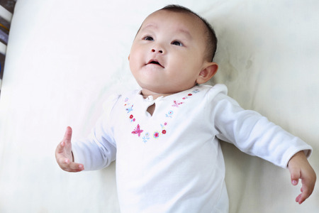 High angle of baby looking up 免版税图像