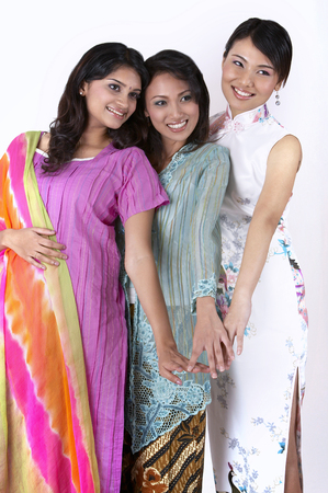3 young women put hand together on the white background