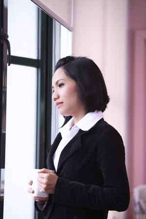 Close up of businesswoman looking out the window