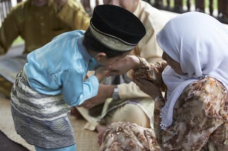 kid greeting to family member Stock Photo