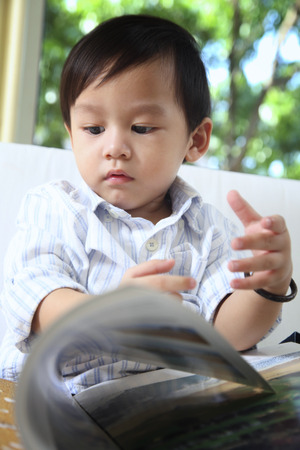 boy flipping the page of story book
