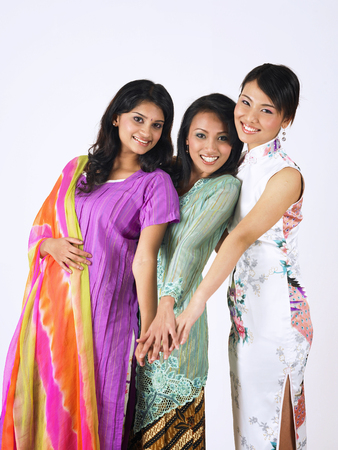 malay,chinese and indian girls put hands together Stock Photo