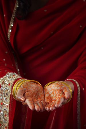 midsection of indian woman with red sari