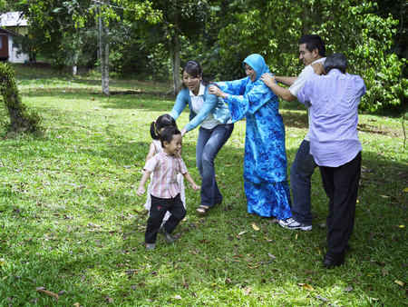 family playing games at the park
