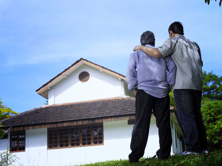 Father and son looking at the house
