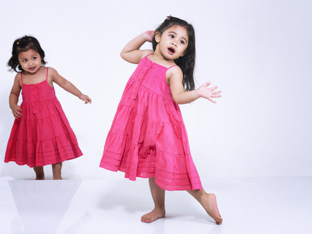 Two little girls dancing