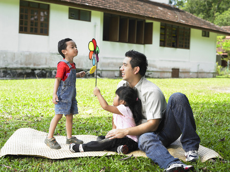 family enjoy playing at back yard