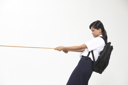 school girl with uniform pulling string