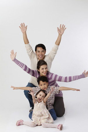 family raising their hands 免版税图像