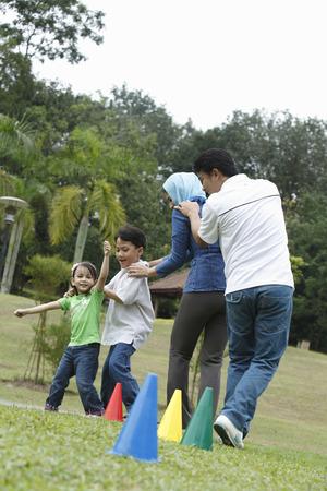 malay family having fun at the park