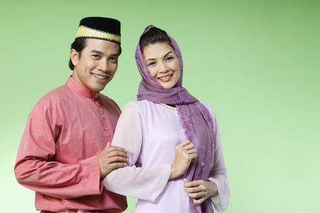 couple with traditional costume looking at camera