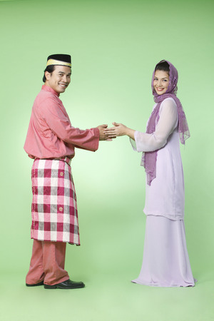 couple with traditional outfit greeting each other