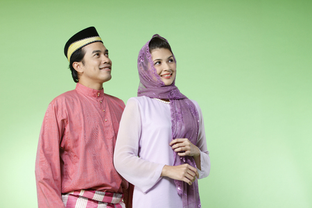 couple with traditional costume looking away