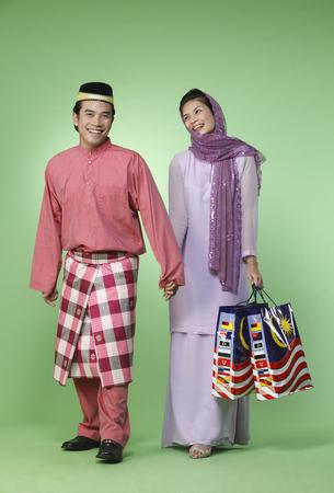 happy couple shopping holding hand