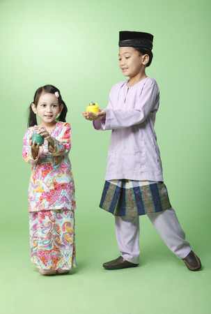 brother and sister holding pelita 스톡 콘텐츠