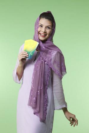 happy malay woman wearing baju kurung holding green packet 写真素材