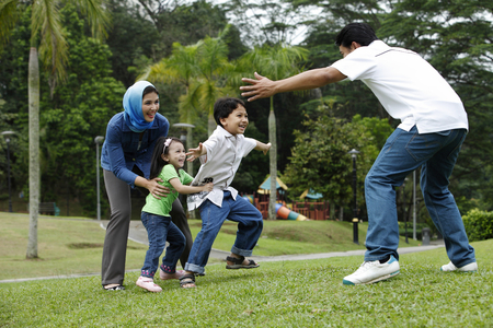 malay family having fun at the park