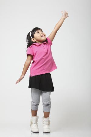 Little girl reaching for something