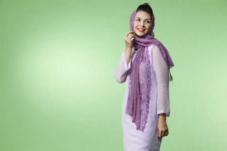 malay woman wearing baju kurung