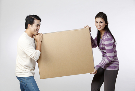 couple holding  a box together