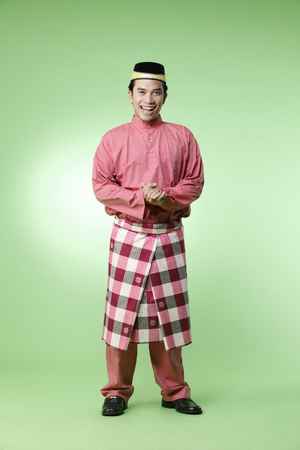 full length of malay man with traditional costume Stok Fotoğraf