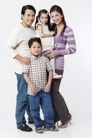family looking at camera Stock Photo