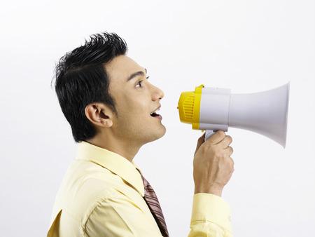 profile of man with loudspeaker Standard-Bild