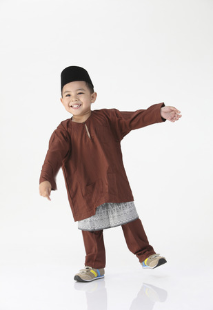 front view of happy malay boy
