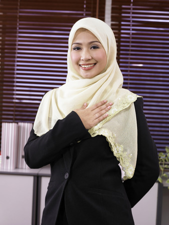 businesswoman with welcome gesture