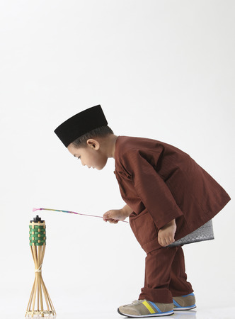 boy pretending playing firework and oil lamp Stok Fotoğraf