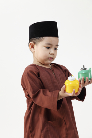 malay boy playing with oil lamp during raya Stok Fotoğraf
