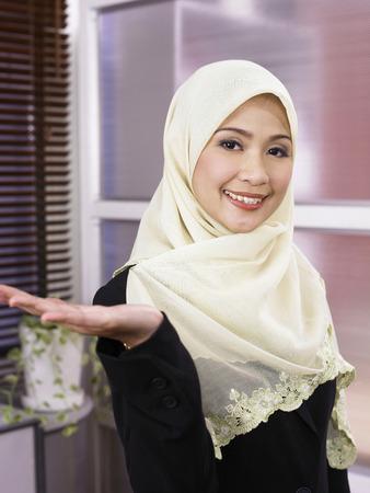 businesswoman showing the direction, smiling Reklamní fotografie