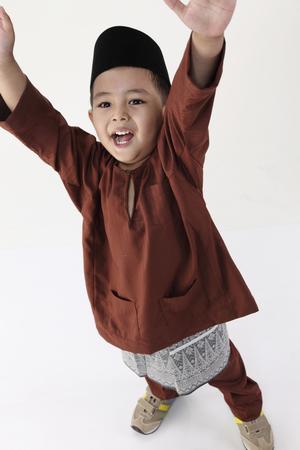 high angle of malay boy with traditional costume