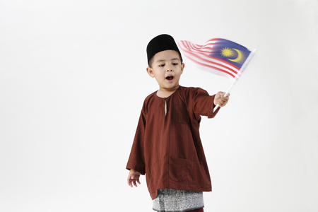 malay boy holding a malaysia flag